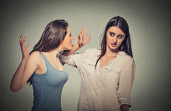 Girl patronizing screaming at shy timid woman Royalty Free Stock Photo