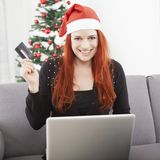 Girl pay with credit card for christmas Stock Images