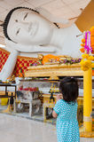 Girl pay respect to Buddha Stock Photography
