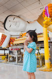 Girl pay respect to Buddha Stock Image