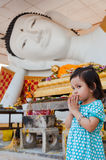 Girl pay respect to Buddha Stock Photo