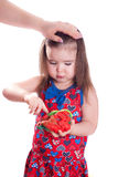 Girl paying with plasticine. On white Royalty Free Stock Photography