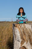 Girl at Peace with Nature. Young girl enjoying a time of rest after a long hike royalty free stock photos
