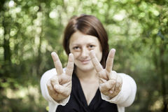 Girl peace symbol Royalty Free Stock Image