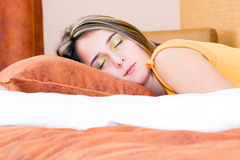 Girl peacefully sleeping in her bed Royalty Free Stock Image