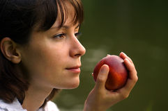 Girl&peach. Young woman with ripe peach Stock Image