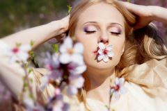 Girl with peach flower in mouth Royalty Free Stock Photography