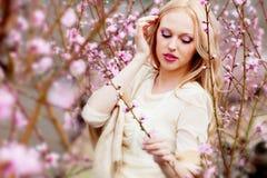 Girl in peach garden Stock Image