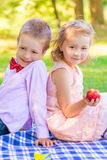Girl with peach and a little gentleman Stock Photos