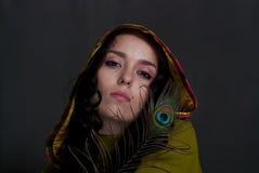 Girl with peacock feather Stock Photos