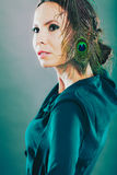 Girl with the peacock feathers Stock Image