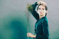 Girl with the peacock feathers Stock Images