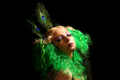 Girl-peacock with green hairs. Girl-peacock in gold dress with green hairs Royalty Free Stock Photo