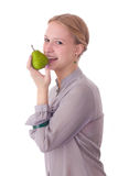 Girl with a pear. Young girl with a pear - isolated on white background stock photography
