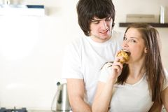 Girl with pear and boy Stock Photo