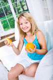 Girl with pear and orange Royalty Free Stock Images