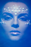 Girl with pearl facial design Stock Images