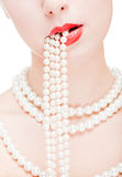 Girl with pearl necklace Stock Photos
