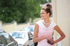 Girl with pearl necklace. Smiling girl with pearl necklace and sunglasses, with copy-space Stock Image