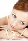 The girl with pearls. The dreaming woman with a pearl necklace on the bared shoulders Stock Images