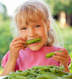 Girl with peas Royalty Free Stock Photo