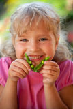 Girl with peas Stock Image