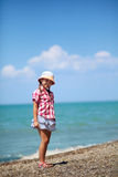 Girl on the pebble beach Stock Photos