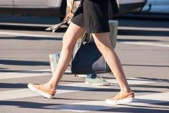 Girl pedestrian walking on a crosswalk Royalty Free Stock Photo