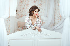 Girl peeking through the headboard. Royalty Free Stock Image