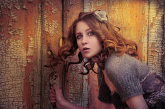 Surprised girl. Girl peeking through the keyhole Stock Photo