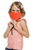 Girl peeking out of heart shape. Little girl peeking out of the edge of heart shape stock photo