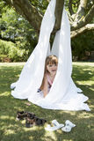 Girl Peeking Out Of Sheet Tent In Backyard Stock Photos