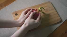 A girl peeled red dragon fruit for making a fruit salad. Slow motion stock video