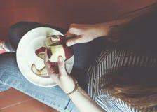 Girl peeling an apple Royalty Free Stock Photo