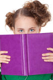 Girl peep behing open book Royalty Free Stock Photo