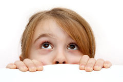 Girl peeping Stock Images