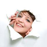 Girl peeping through hole in paper Stock Photography