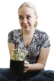 Girl peggin money Stock Image
