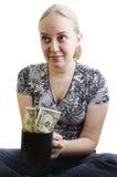 Girl peggin money Stock Image