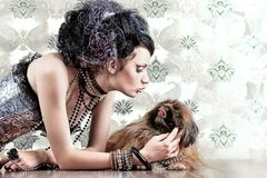 Girl with pekingese Stock Images