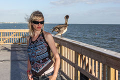 Girl with pelican Stock Images