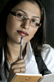 Girl with pen Stock Photography