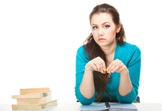 Girl with pen and books Royalty Free Stock Photography