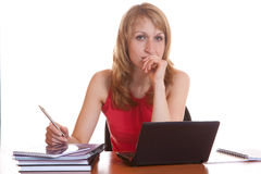 The girl with a pen looking at the screen notebook. On white background royalty free stock image