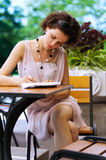 Girl with pen outdoors Stock Images