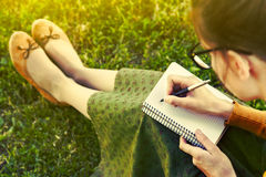 Girl with pen writing Stock Photo