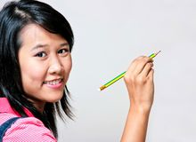Girl and pencil Royalty Free Stock Image