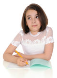 The girl with pencil and writing-book Stock Images