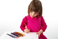 Girl with pencils. Three years old girl, drawing with coloring pencil Stock Photography