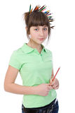 Girl with pencils Stock Images